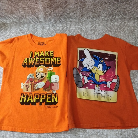 2 boys size 7 T shirts
